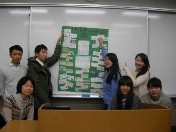Students proudly displaying their poster on Immigrant Communities of Japan
